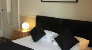 double bed with black bedding